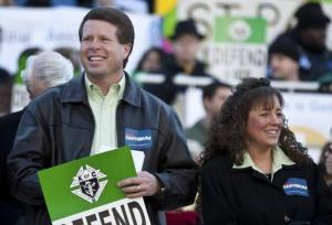 Jim Bob Duggar (L) and his wife Michelle Duggar (R), supporters of Republican presidential candidate and former Pennsylvania Senator Rick Santorum, attend a Pro-Life rally  in Columbia, South Carolina, on the steps of the State House January 14, 2012. REUTERS/Chris Keane