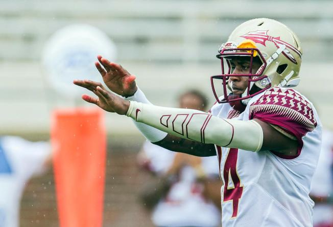 Florida State QB Johnson dismissed from team after video shows him punching woman in theface