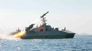 KCNA picture shows a test-firing drill of anti-ship missiles at sea