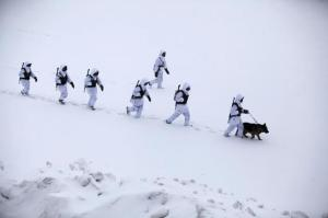 Soldiers of China's PLA patrol in temperatures below minus 10 degrees Celsius at China's border with Russia in Heihe