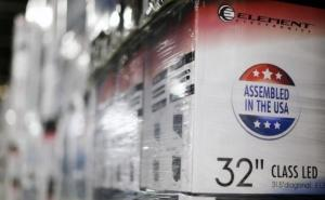 "An ""Assembled in the USA"" stamp is seen at the side of a box containing a 32-inch TV set in the warehouse of Element Electronics, in Winnsboro"