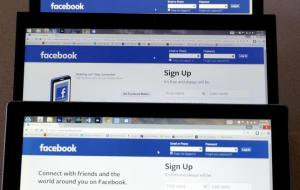 Computer screens display the Facebook sign-in screen in this photo illustration taken in Golden