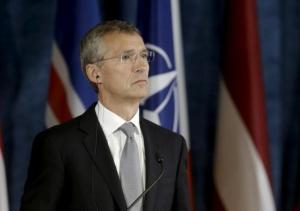 NATO Secretary General Stoltenberg listens during a news conference after the NATO Force Integration Unit inauguration in Vilnius