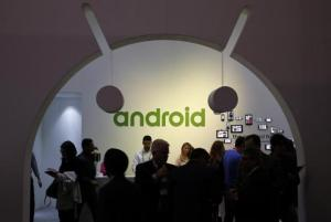 People visit an Android stand at the Mobile World Congress in Barcelona
