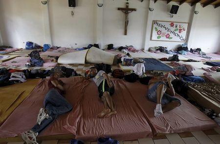 Cubans migrants rest at a shelter in La Cruz