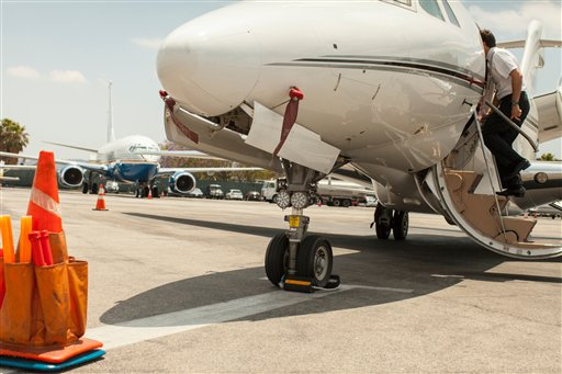 Male private jet pilots boarding plane at airport